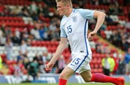Moore On Target In England Rout