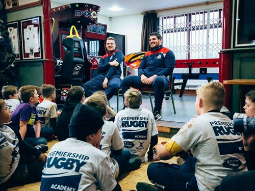 First Team Duo Visit Community Foundation Christmas Camp