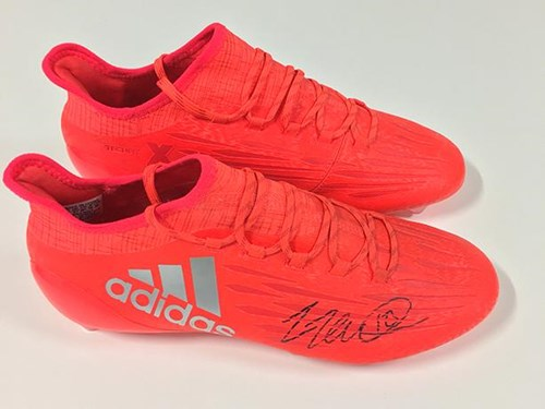 Community Trust Puts Tomlin's Boots Up For Auction
