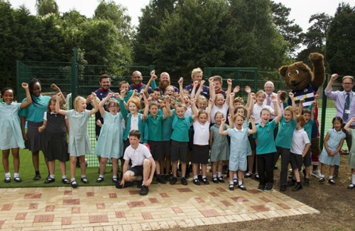 Players visit St Helens Primary for MUGA pitch opening