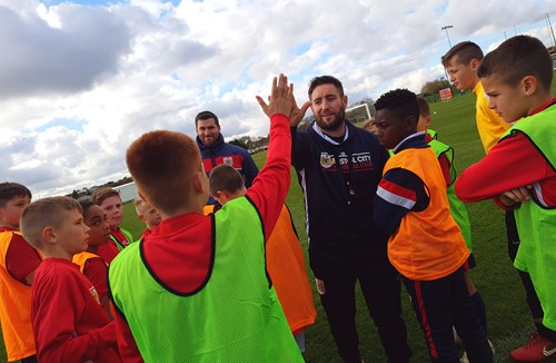 City first team coaches train young Robins on Academy visit