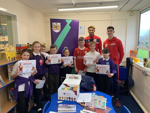 Players surprise primary school students with a visit