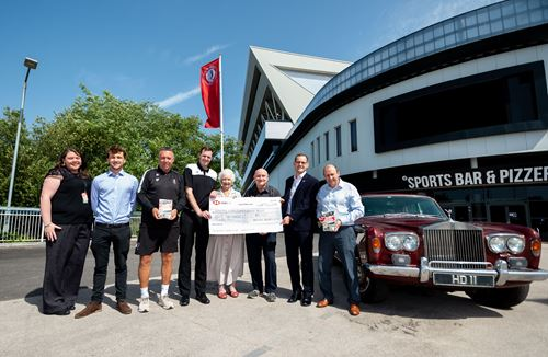 Community Trust presented £8000 from the sale of Harry Dolman book