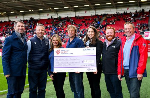 Amarelle and RICS present cheque to sporting charities