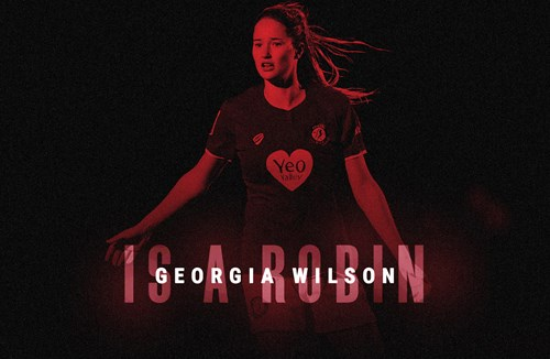 Wilson signs first professional deal