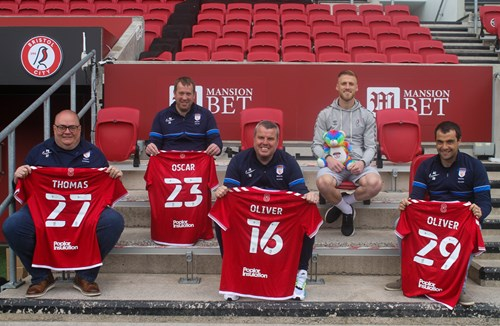 Pitchside presentation with members of Bristol Sands United and City's Dan Bentley