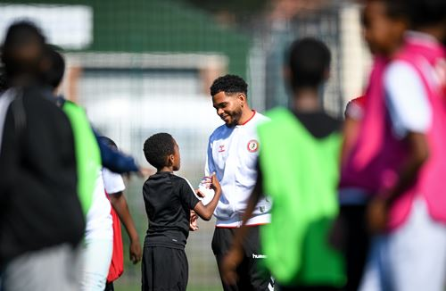 Squad supports Foundation's free football and food camps